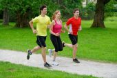Group of athletes jogging — Stock Photo