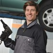 Mechanic working under the car — Stock Photo #57240697