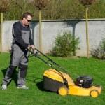 Lawn mower man working — Stock Photo #57240909