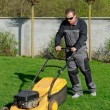 Lawn mower man working — Stock Photo #57241171