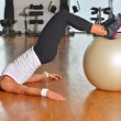 Woman exercising fitness ball — Stock Photo #57241229