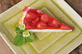 Strawberry cheesecake on a plate — Stock Photo