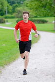 Young athlete running — Stock Photo