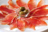 Ham and olives — Stock Photo