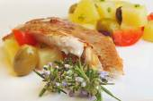 Fish fillet with vegetables, potato and olives — Stock Photo