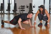 Female personal trainer working with her trainee — Stock Photo