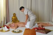 Young beautiful female receiving massage — Stock Photo