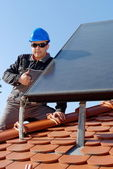 Man installing solar panels — Stock Photo