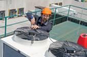 Man repair Air Conditioning — Stock Photo