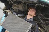 Car mechanic is Changing radiator — Stock Photo