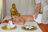 Young beautiful female receiving massage — Stock Photo