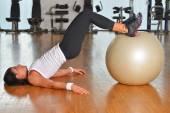 Woman exercising fitness ball — Stock Photo