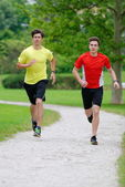 Two athletes jogging — Stock Photo
