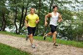 Two young athletes jogging — Stock Photo