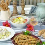 Fried sardines with potato salad — Stock Photo #58354805