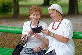 Two senior ladies reading news — Stock Photo