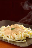 Creamy sauce with pasta — Stock Photo
