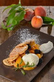 Belgian waffles with fresh peaches — Stock Photo