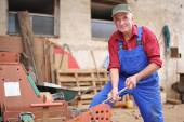 Farmer repairing his red tractor — Stock Photo