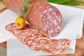 Salami with olive — Stock Photo