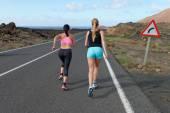Two female running athletes. — Stock Photo