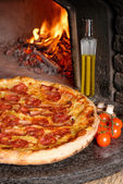Baked tasty pizza with salami — Stock Photo