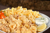 Fried calamari with french fries — Stock Photo