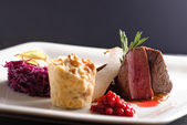 Venison meat steak with red cabbage — Stock Photo