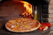 Pizza with prosciutto — Stock Photo