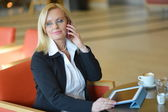 Attractive middle-aged blond businesswoman — Stock Photo