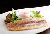 Steamed fish fillet with poached egg — Stock Photo