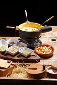 Cheese fondue with nuts — Stock Photo