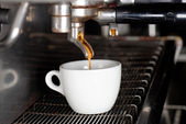 Espresso machine brewing a coffee — Stock Photo
