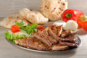 Wholesome platter of mixed meats — Stock Photo