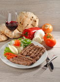 Cevapcici, a small skinless sausage cooked on the barbecue — Stockfoto