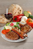 Mixed grill on a plate — Stock Photo