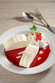 Panna cotta with currant sauce — Stock Photo