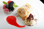 Strudel with ice cream and berries dessert — Stock Photo