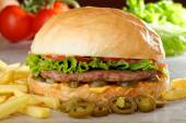 Big juicy Mexican burger with spicy jalapenos — Stock Photo