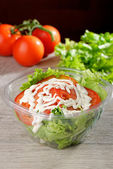 Salad in takeaway container — Stock Photo