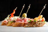 Tapas on Crusty Bread — Stock Photo