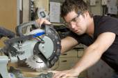 Carpenter at work on job using power tool — Stock Photo