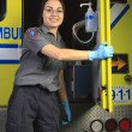 A paramedic, closing the door of the ambulance. — Stock Photo #63922319