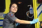 A paramedic, closing the door of the ambulance. — Stock Photo