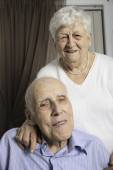 Portrait of a happy senior couple in apartement — Stock Photo