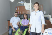 A dental office with employee and client — Stock Photo