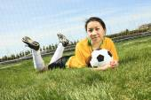 Portrait of young Asian girl with soccer ball. — Stock Photo