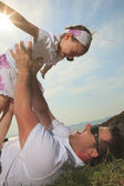 A father and daughter having fun outside — Stock Photo