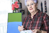 A Portrait of a happy senior woman at home — ストック写真