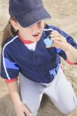 A baseball player having a asthma crisis — Stock Photo
